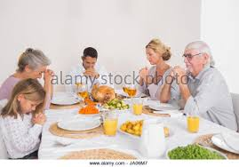 family saying grace thanksgiving stock photos family