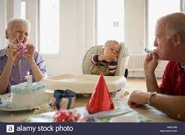 babys birthday grandparents at babys birthday party stock photo royalty free
