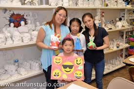 family enjoys canvas and ceramic painting