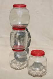 hoosier vintage glass jars w red painted metal lids pantry