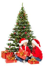 christmas kids in santa hat under xmas tree open present gift box