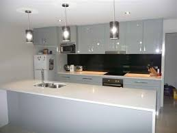 small kitchen design with l shaped black stained wooden cabinet