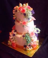 fruit and flowers still life themed tiered fondant birthday cake