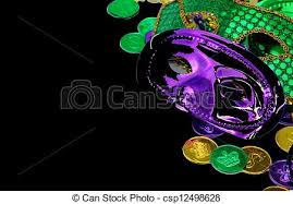green mardi gras green mardi gras masks and coins isolated on black stock photo