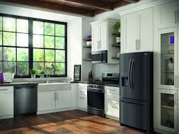 gray kitchen cabinets with black stainless steel appliances black stainless appliance finish remodeling industry news
