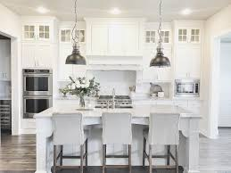 white kitchens with islands gray and white kitchen with metal pendant ls over large marble