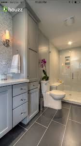 bathroom dark grey tile flooring light grey cabinets white