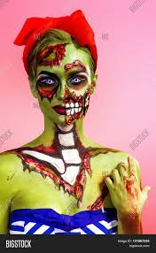 halloween portrait background portrait of a pin up zombie woman over pink background body