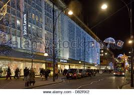 christmas shoppers outside john lewis shop front cardiff wales