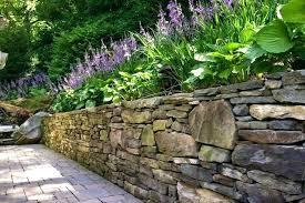 Garden Rock Wall Rock Wall Gardening Ideas Garden Ideas A Boulder Retaining Wall