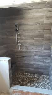 Shower Tile Ideas by Cool Wood Grain Porcelain Shower And River Rocks Stephen Belyea