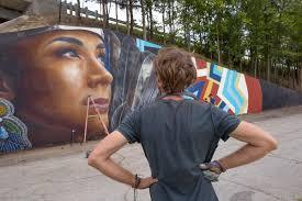 australian street artist creates murals in greensboro blog go australian mural artist