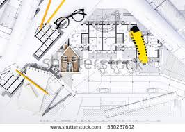 construction plans construction plans drawing tools on blueprints stock photo