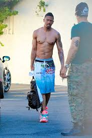 nick cannon shows off enormous tattoo of jesus which covers ex