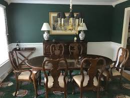 our new dining room with behr dark everglade over sherwin williams
