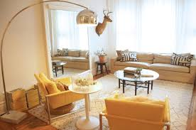 mid century modern arc floor l lighting ideas two yellow chairs and small round table also large