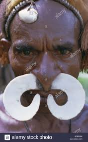 portrait of an asmat with nose ornament papua new guinea
