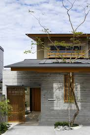 attractive japanese house design exterior with natural cement wall