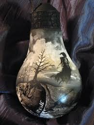 painted lightbulb ornament by the gnarled branch on deviantart