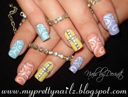 easy easter pretty pastel nail art design with rhinestone cross