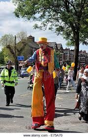 clown stilts clown stilts walker stock photos clown stilts walker stock