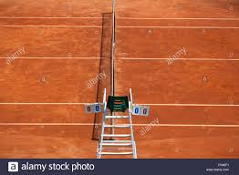 umpire chair with scoreboard on a tennis court before the game the playground is empty