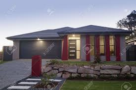 stylish suburban house front at dusk stock photo picture and