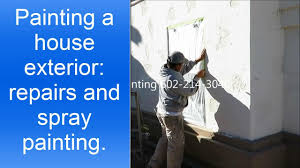 exterior house painting preparation and spray painting stucco