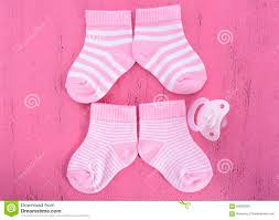 its a baby shower or nursery concept with socks on pink woo
