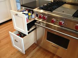 pull out spice rack next to wolf 4 burner gas range with griddle