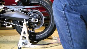 street triple chain adjustment youtube