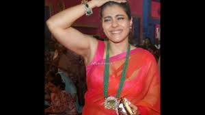 mummy kajol in a sleeveless blouse and transparent saree