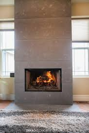 engineered concrete panels around wood fireplace feature wall