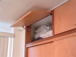 Overhead Cabinet Door Hinges Cabinet Doors That Open Upward Home Design Ideas And Pictures