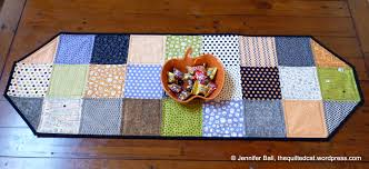 easy charm square halloween table runner tutorial the quilted cat