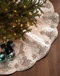 gold tree skirt our sweet snowy tree skirt features sparkly embroidered scrolls on