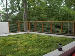 Modern Backyard Fence by Wood And Metal Fence Ideas Landscape Modern With Breezes D Outdoor