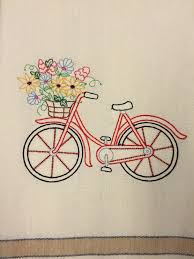 embroidered tea towel with bicycle and flower basket embroidery