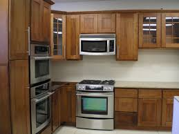 Wall Backsplash Nice Brown Wooden Kitchen Cabinet As Well As Chrome Microwave