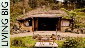 homes built into hillside magical hobbit like eco cave house