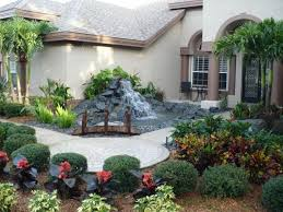 palm tree landscaping ideas front yard symmetrical landscaping
