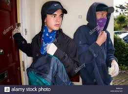 Burglars Teenage Boy Burglars Leaving A House With Valuables In A Backpack
