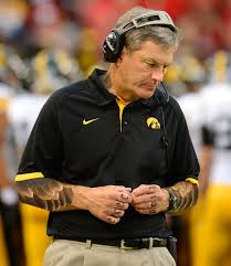 kirk ferentz loses friendly wager gets first tattoo black heart