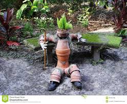 clay pot man in garden stock photo image of heliconias 31907786