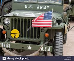 jeep front view front view of a willys jeep with american flag 2nd world war