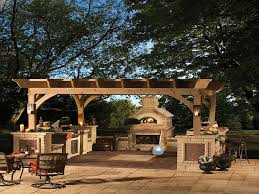 like this outdoor kitchen along with fireplace and its partially