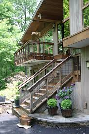 horizontal deck railing exterior rustic with outdoor fireplace