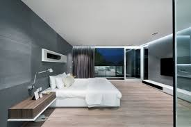 modern master bedroom with chrome varnished chandelier over king