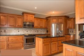 kitchens with black appliances and oak cabinets kitchen blue kitchen cabinets paint colors for light wood floors