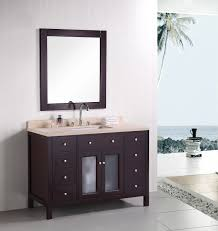 bathroom wooden flooring with single sink vanity and drawer also